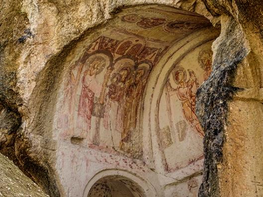 frescoes-exposed-interior-of-rock-church-goreme